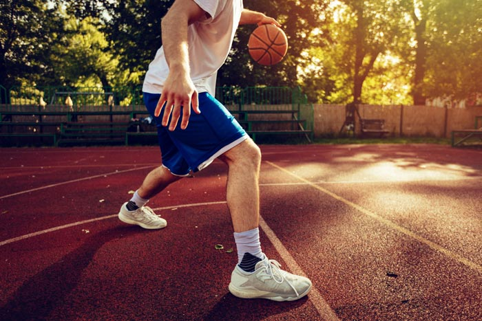 man playing basketball outside - recreational therapy