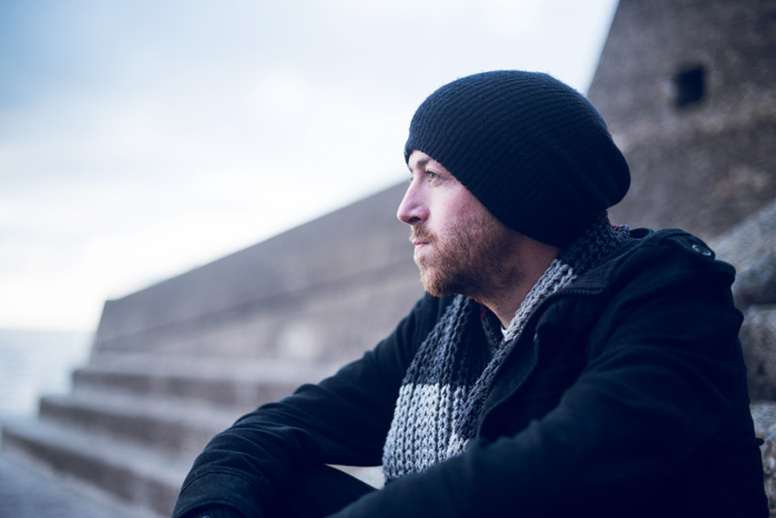 man sitting outdoors during winter - seasonal affective disorder