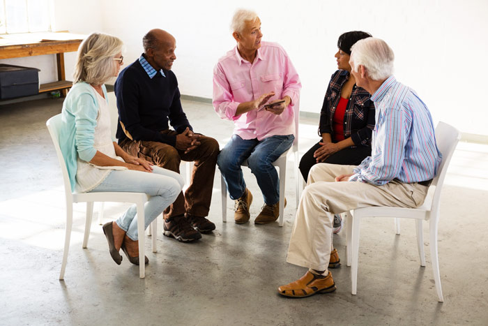 group of older adults in group therapy - outpatient