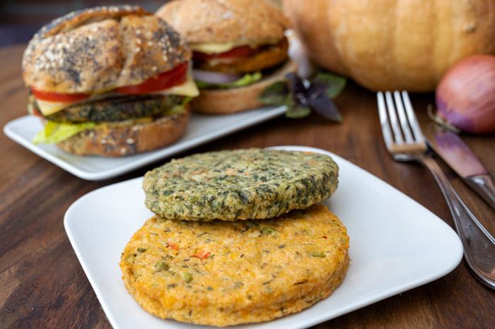 veggie burgers on plates - plant-based